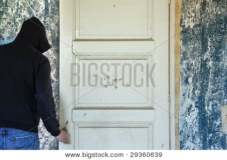 Man Opening Door Of Decayed Room