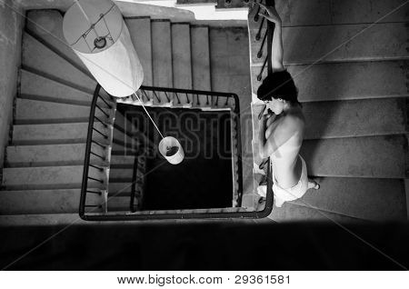 Overhead View Of Woman In Stairwell