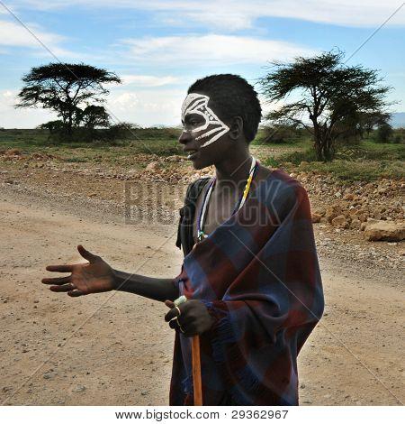 OLDUVAI GORGE, TANZANIA, DECEMBER 23, 2011, MAASAI BOY WITH PAINTED FACE