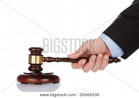 Human Hand Holding A Gavel