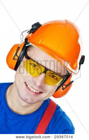 close-up Portrait of young builder in protective safety equipment goggles hard hat earmuffs isolated