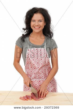 Beautiful Housewife Cutting Meat.