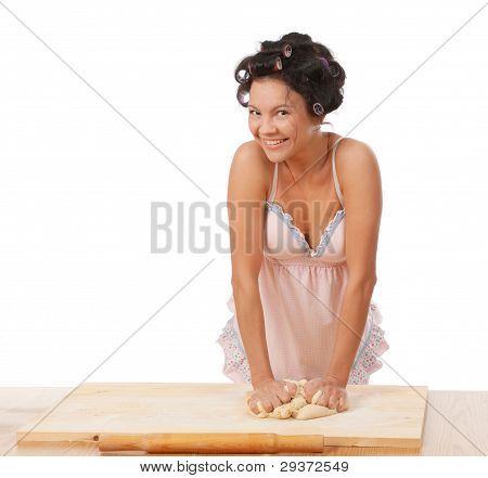 Housewife Mix Dough On The Wooden Board.