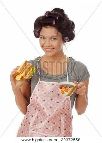 Sexy Housewife Drinking Tea With Sandwich