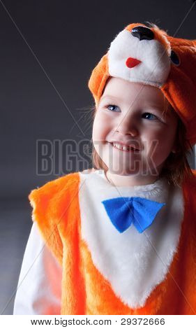 Little baby girl  dressed in a fox suit