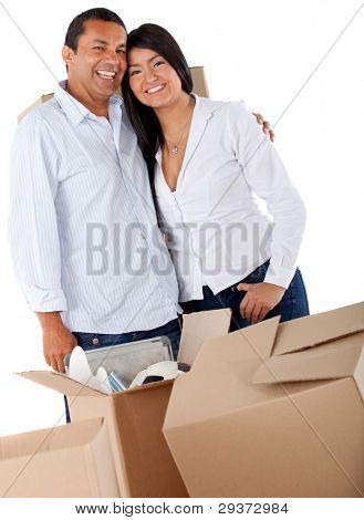 Couple moving house and packing in boxes