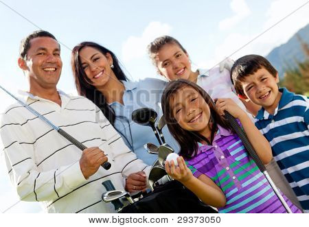 Portrait of a beautiful happy family playing golf