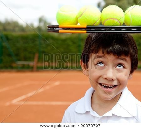 Male tennis player a racket and balls on top of his head