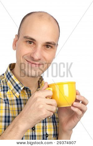 Young Man Drinking A Cup Of Tea