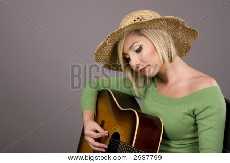 Blonde Strumming Guitar