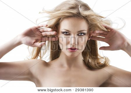 Sensual Pretty Woman With Flying Hair, Her Both Hands Are Open Near The Face