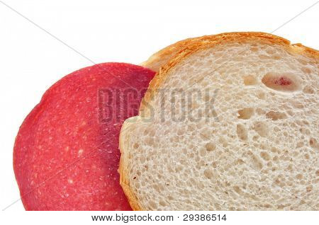 closeup of a salami sandwich on a white background