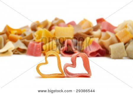 a pile of uncooked vegetables heart shaped pasta