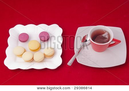 Cup Of Tea And Smile Of Macaroons On Velvet Tablecloth