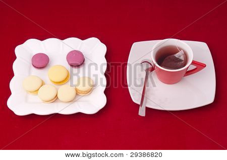 Cup Of Tea And Smile Of Macaroons On A Velvet Tablecloth (3)
