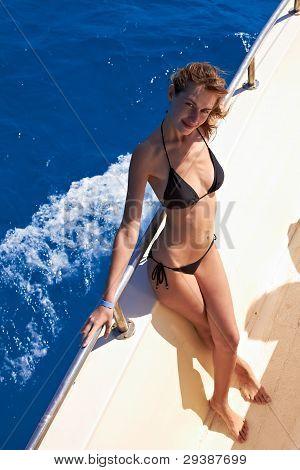 Young Woman In Bikini Posing On Yacht