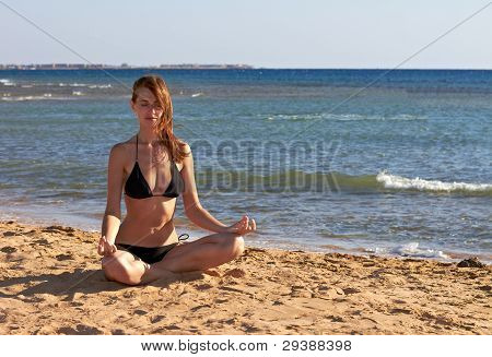 Woman In Yoga Lotus Meditation Back To Seaside