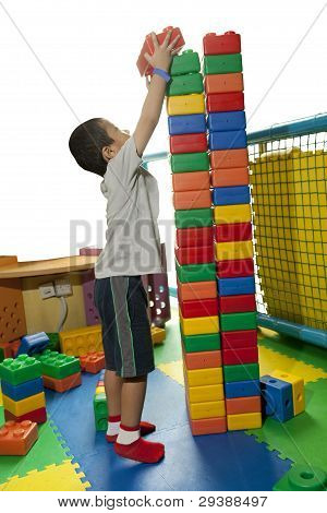 Boy Building a Tower of Blocks