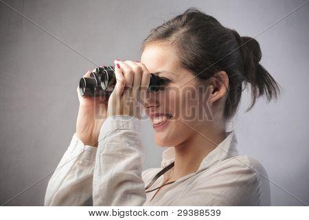 Beautiful woman using binoculars