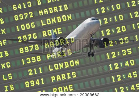 Flight Board and Airliner Landing at the Airport