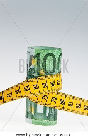 an icon image austerity package with a tape measure and bill â?¬