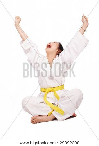Young woman has a rest after a taekwondo training,isolated on white.
