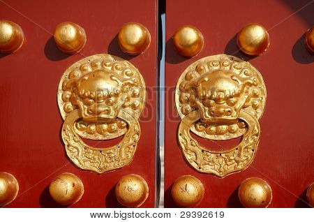 old Chinese red door with dragon head knob