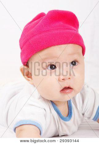 cute baby wearing a pink cap