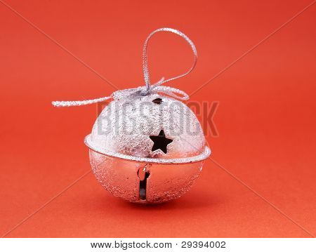 jingle bell on red background.