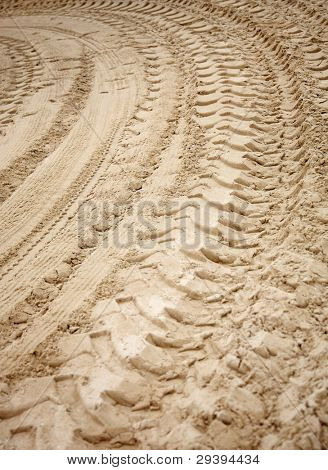 Track of big tires on sand