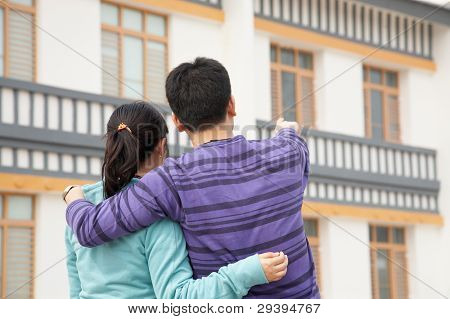 Couple looking at their new house.