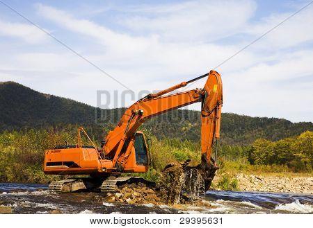 excavator dredging sediment mud