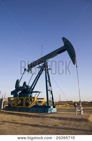 oil pump jack at dusk