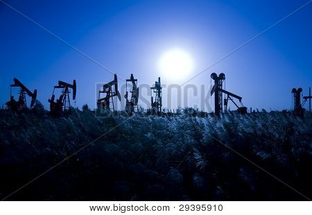 Silhouette of oil pump jacks  with beautiful sunset