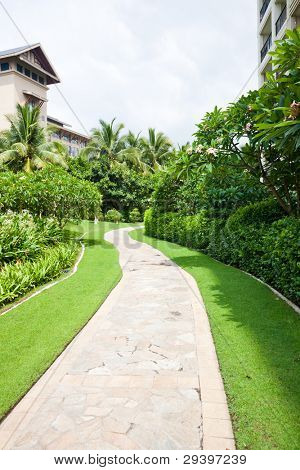 stone paved path through garden