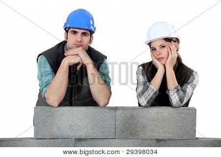 Unhappy team of bricklayers