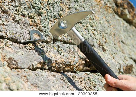 In Hook Hammer Into Crack Of Rock Hammer
