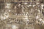 stock photo of fighter-fish  - Ancient Khmer bas relief carving showing Cham fighters taking part in a naval battle on the Tonle Sap lake in Cambodia - JPG