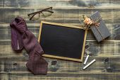 Flat Lay Image Of Gift Box, Necktie, Glasses And Blank Space Chalkboard. Fathers Day, Valentines D poster