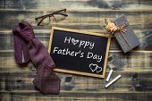 Happy Fathers Day Concept. Flat Lay Image Of Gift Box, Necktie, Glasses And Chalkboard With Happy F poster