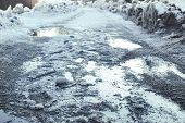 Melting Snow And Puddles On The Road. Spring Afternoon. poster