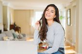 Beautiful brunette woman smiling cheerful with big smile, looking positive and happy poster