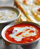 pic of tadka  - Indian curry raitha and roti closeup photo