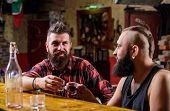 Lets Get Drunk. Hipster Brutal Bearded Man Spend Leisure With Friend At Bar Counter. Men Relaxing At poster