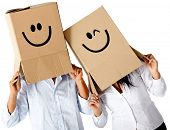 picture of incognito  - Couple of cardbord characters with smiley faces  - JPG