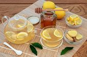 Cold and flu remedy medicinal ingredients with ginger spice, lemon fruit, honey and hot drink in a g poster