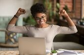 Excited African Woman Feeling Winner Rejoicing Online Win On Laptop poster
