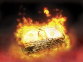 picture of money stack  - stack of dollar bills on fire - JPG
