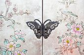 stock photo of curio  - Beautiful butterfly lock on the door of  old Chinese furniture - JPG