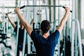 Portrait Handsome Caucasian Young Man Healthy Fitness Doing Exercise At Indoor Workout In Gym. Peopl poster